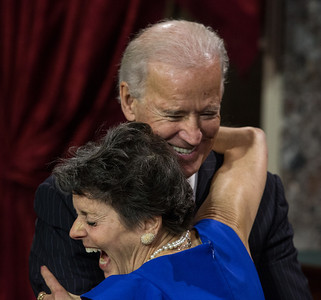 Vice President Joe Biden gets a hug from Mary Herman, wife of U.S. Senator Angus King (I-ME) during a reenacted swearing-in. The ceremonial event took place in the Old Senate Chamber inside the U.S. Capitol Building in Washington D.C. on January 3, 2013. The official swearing-in ceremony happened earlier in the Senate chambers on the opening day of the 113th Congress. (Photo by Jeff Malet).