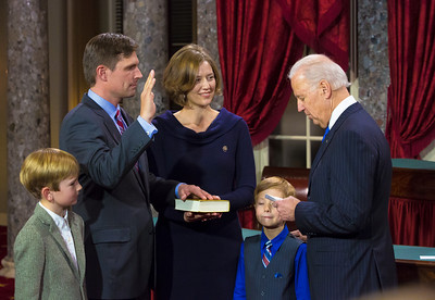 U.S. Senator Martin Heinrich (D-NM) (left) participates in a reenacted swearing-in with wife Julie Heinrich and sons Carter and Micah with Vice President Joe Biden. The ceremonial event took place in the Old Senate Chamber inside the U.S. Capitol Building in Washington D.C. on January 3, 2013. The official swearing-in ceremony happened earlier in the Senate chambers on the opening day of the 113th Congress. (Photo by Jeff Malet).