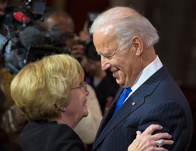 "Vice President Joe Biden embraces Ellen Casey (left), the mother of Senator Bob Casey (D-PA), exclaiming ""Guys, other than my mother, this is the finest lady I've ever known"". Senator Casey participated in a reenacted swearing-in with his wife Terese Foppiano Casey and Biden. The ceremonial event took place in the Old Senate Chamber inside the U.S. Capitol Building in Washington D.C. on January 3, 2013. The official swearing-in ceremony happened earlier in the Senate chambers on the opening day of the 113th Congress. (Photo by Jeff Malet)."