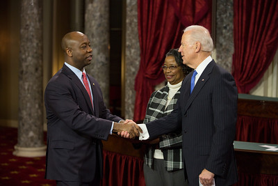 U.S. Senator Tim Scott (R-SC) (left) participates in a mock swearing-in with his mother Frances Scott and Vice President Joe Biden. The ceremonial event took place in the Old Senate Chamber inside the U.S. Capitol Building in Washington D.C. on January 3, 2013. The official swearing-in ceremony happened earlier in the Senate chambers on the opening day of the 113th Congress. (Photo by Jeff Malet).