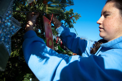 Adriana Chacon of Senora California helps decorate the 47th Capitol Christmas tree on December 2, 2011. The 63 foot Sierra white fir from California's Stanislaus National Forest arrived in Washington D.C. a few days earlier, following a 20-day tour across the country. The tree will be decorated with more than 10,000 LED lights and some 2,000 handmade ornaments from the State of California. (Photo by Jeff Malet)