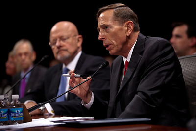 CIA Director, David Petraeus (right) and Director of National Intelligence, James Clapper (left) testified at a joint congressional intelligence committee hearing on Capitol Hill on Tuesday, September 13, 2011 in Washington DC. America's top two intelligence officials told Congress that al-Qaeda is weaker and U.S. intelligence agencies are smarter since the 9/11 attacks, but that the terrorists are still dangerous and are not close to giving up. (Photo by Jeff Malet)