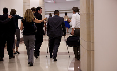 Keith Ellison (D-MN) (on crutches) takes questions from reporters on the way to a crucial vote on the debt deal. The Congressional Progressive Caucus and its co-chair, Ellison, came out against the debt ceiling deal of President Barack Obama and congressional leadership. At a just completed press conference on Capitol Hill in Washington DC on August 1, 2011, Ellison said tea party-aligned members of the Republican Party have held our economy hostage by demanding large cuts and opposing tax increases in exchange for raising the debt limit. (Photo by Jeff Malet)