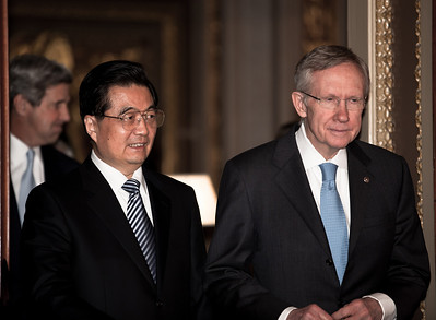 Chinese President Hu Jintao meets with US Senate majority leader Harry Reid, who had earlier called Mr Hu a dictator, on Jan. 20, 2011, on Capitol Hill in Washington DC. (Photo by Jeff Malet)