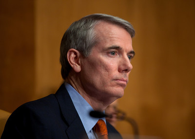 Senator Rob Portman (R-OH) listens to Douglas Elmendorf, the director of the Congressional Budget Office, at his testimony on the budget and economic outlook before the Senate Budget Committee on Thursday January 27, 2011 on Capitol Hill in Washington DC.  Elmendorf suggested that an overhauled tax code could be more effective at raising revenue, but the economy could not grow the government out of its current debts.  Elmendorf said that it is nearly impossible to predict a debt crisis because it depends on a mix of economic trends and events as well as market perceptions of these circumstances. The CBO estimated that week that the deficit for fiscal year 2011 would grow to $1.5 trillion. (Photo by Jeff Malet)