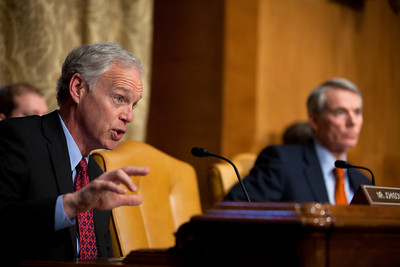 Senator Ron Johnson (R-WI) questions Douglas Elmendorf, the director of the Congressional Budget Office, at his testimony on the budget and economic outlook before the Senate Budget Committee on Thursday January 27, 2011 on Capitol Hill in Washington DC. The CBO estimated that week that the deficit for fiscal year 2011 would grow to $1.5 trillion. In photo Senator Rob Portman (R-OH) sits in background. (Photo by Jeff Malet)