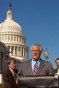 Rep. Barney Frank (D-MA), Ranking Member of the full House Financial Services Committee, hailed the first 100 days of the Consumer Financial Protection Bureau on November 2, 2011 in Washington D.C. Framed by the Capitol Dome, Frank spoke at an outdoor press conference on the House side of the Capitol's East Front. He was joined by Rep. Carolyn Maloney (D-NY), Ranking Member of the Financial Institutions and Consumer Credit Subcommittee of the House Financial Services Committee. (Photo by Jeff Malet)