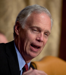 Senator Ron Johnson (R-WI) questions Douglas Elmendorf, the director of the Congressional Budget Office, at his testimony on the budget and economic outlook before the Senate Budget Committee on Thursday January 27, 2011 on Capitol Hill in Washington DC.  Elmendorf suggested that an overhauled tax code could be more effective at raising revenue, but the economy could not grow the government out of its current debts.  Elmendorf said that it is nearly impossible to predict a debt crisis because it depends on a mix of economic trends and events as well as market perceptions of these circumstances. The CBO estimated that week that the deficit for fiscal year 2011 would grow to $1.5 trillion. (Photo by Jeff Malet)