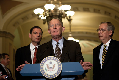 Senator Lamar Alexander speaks with reporters on Capitol Hill in Washington, Tuesday, July 19, 2011, following the weekly Republican policy meeting. Alexander was joined by Senate Minority Leader Mitch McConnell (R-KY) (right) and Senator John Barrasso (R-WY) (left). (Photo by Jeff Malet)