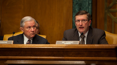 Committee Chairman Senator Kent Conrad (D-ND) (right) questions Douglas Elmendorf, the director of the Congressional Budget Office, at his testimony on the budget and economic outlook before the Senate Budget Committee on Thursday January 27, 2011 on Capitol Hill in Washington DC.  Elmendorf suggested that an overhauled tax code could be more effective at raising revenue, but the economy could not grow the government out of its current debts.  Elmendorf said that it is nearly impossible to predict a debt crisis because it depends on a mix of economic trends and events as well as market perceptions of these circumstances. The CBO estimated that week that the deficit for fiscal year 2011 would grow to $1.5 trillion. Senator Jeff Sessions (R-AL), ranking member of the Committee is pictured on left in photo.  (Photo by Jeff Malet)