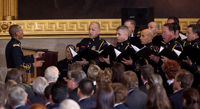 """The 50th anniversary of John F. Kennedy's inaugural address was marked with speeches celebrating Kennedy's famous call on Americans to serve their country. Here the United States Army Chorus sings Woody Guthrie's """"This Land is Your Land"""". Vice President Joe Biden and JFK's daughter Caroline Kennedy were among the speakers at the ceremony in the central Rotunda of the United States Capitol. The event was held a half-century after Kennedy's 1961 address, on January 20, 2011 in Washington DC. Many members of the extended Kennedy Family were in attendance  (Photo by Jeff Malet)"""