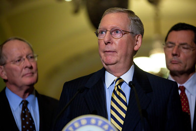 Senate Minority Leader Mitch McConnell (R-KY), speaks with reporters on Capitol Hill in Washington, Tuesday, July 19, 2011, following the weekly Republican policy meeting. McConnell is joined by Senators Lamar Alexander (R-TN) and John Barrasso (R-WY). (Photo by Jeff Malet)