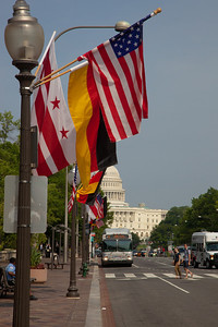 Flags of Germany, the United States and the District of Columbia line Pennsylvania Ave. between the White House and the Capitol  in Washington DC for the state visit of German Chancellor Angela Merkel on Tuesday, June 7, 2011.  (Photo by Jeff Malet)