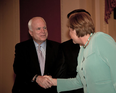 German Chancellor Angela Merkel shakes hands with Sen. John McCain (R-AZ) on Capitol Hill in Washington DC, Tuesday, June 7, 2011.  (Photo by Jeff Malet)