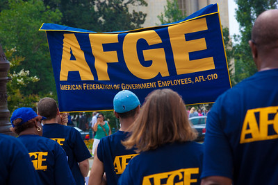 "The American Federation of Government Employees (AFGE) march to a rally to ""Save the American Dream"" on Capitol Hill in Washington DC on Thursday, July 28, 2011. ""In the past few days, it's become increasingly clear that congressional Republicans are willing to crash our entire economy just to keep tax breaks for millionaires, billionaires, corporate jet owners and oil companies,"" says the AFL-CIO. ""They're holding our economy hostage, but we still have the power to rise up and demand Congress raise the debt ceiling without a budget that savages working families."" (Photo by Jeff Malet)"
