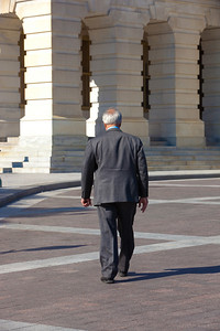 Rep. Barney Frank (D-MA) walks by himself toward the Capitol along the House side of the Capitol's East Front on November 2, 2011 in Washington D.C. Later in the month, he would announce that he will not seek reelection in 2012, after 16 terms in office. (Photo by Jeff Malet)