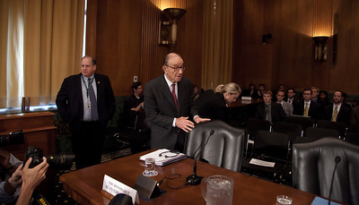 Former Federal Reserve Chairman Alan Greenspan makes his entrance at a hearing of the Senate Finance Subcommittee on Fiscal Responsibility and Economic Growth to focus on deficits, with additional testimony former Treasury Undersecretary John Taylor, former Reagan economic adviser Martin Feldstein, former Michigan Gov. John Engler, and Edward Kleinbard, former chief of staff of the Joint Committee on Taxation. The hearing took place on Tuesday September 13, 2011 on Capitol Hill in Washington DC. The panelists were questioned on whether changing the tax code could help reduce the federal deficit. Senator Bill Nelson (D-FL), chaired the hearing, Greenspan told the subcommittee that he supports eliminating what he called unnecessary tax breaks in order to help cut the deficit and avoid a federal budget crisis, and that tax cuts that are paid for by borrowing are undesirable. He also said entitlement spending is a major contributor to the debt and that it will only get worse as the population ages. He also said that there is no credible way to control the government's debt without inflicting pain on the economy. (Photo by Jeff Malet)