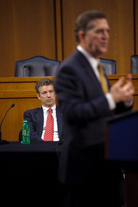 Senator Jim DeMint (R-SC) speaks at the first meeting of the Senate Tea Party Caucus on Thursday January 27, 2011 on Capitol Hill in Washington DC. Senator Rand Paul (R-KY) sits in the background. (Photo by Jeff Malet)