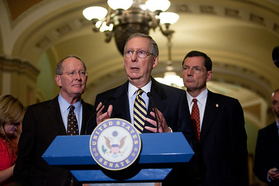 Senate Minority Leader Mitch McConnell (R-KY), speaks with reporters on Capitol Hill in Washington, Tuesday, July 19, 2011, following the weekly Republican policy meeting. McConnell is joined by Senators Lamar Alexander (R-TN) (left) and John Barrasso (R-WY) (right). (Photo by Jeff Malet)