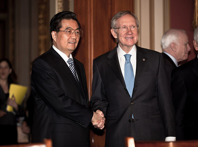 Chinese President Hu Jintao shakes hands with US Senate majority leader Harry Reid, who had earlier called Mr Hu a dictator, on Jan. 20, 2011, on Capitol Hill in Washington DC. (Photo by Jeff Malet)