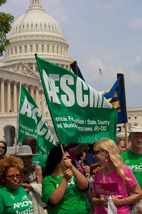 "Members of AFSCME (American Federation of State County and Municipal Employees) participate at a rally to ""Save the American Dream"" on Capitol Hill in Washington DC on Thursday, July 28, 2011 to tell Democrats to stand strong against Republican debt ceiling proposals that cut Social Security, Medicare and Medicaid while keeping keep tax breaks for millionaires, billionaires and oil companies. Participants included major labor unions such as AFSCME, CWA, AFGE, Teamsters, and various progressive groups such as Move-On, Rebuild the Dream, Jobs with Justice, Gray-Panthers and Code-Pink. (Photo by Jeff Malet)"