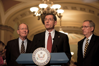 Senator John Barrasso (R-WY) speaks with reporters on Capitol Hill in Washington, Tuesday, July 19, 2011, following the weekly Republican policy meeting. Barrasso was joined by Senate Minority Leader Mitch McConnell (R-KY) (right) and Senator Lamar Alexander (R-TN)(left). (Photo by Jeff Malet)