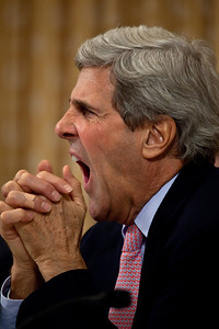 Supercommittee member Senator John Kerry (D-MA) stifles a yawn during proceedings. Congress' Joint Select Committee on Deficit Reduction, also known as the Supercommittee, held a public hearing on Capitol Hill in Washington DC on November, 1, 2011. Witnesses included former Sen. Alan Simpson (R-WY) and Erskine Bowles, co- chairmen, National Commission on Fiscal Responsibility and Reform. Also testifying were Alice Rivlin, former vice chairwoman, Federal Reserve, and former director, Office of Management and Budget and former director, Congressional Budget Office; and former Sen. Pete Domenici (R-NM). (Photo by Jeff Malet)