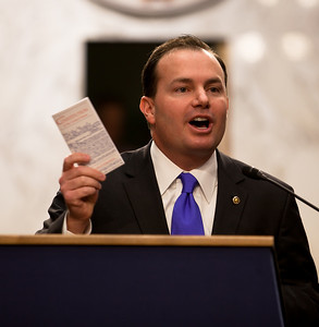 Senator Mike Lee (R-UT) holds up a copy of the US Constitution at the first meeting of the Senate Tea Party Caucus on Thursday January 27, 2011 on Capitol Hill in Washington DC. (Photo by Jeff Malet)