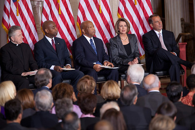 The 50th anniversary of John F. Kennedy's inaugural address was marked with speeches celebrating Kennedy's famous call on Americans to serve their country. (Seated left to right)  Reverand Daniel P. Coughlin, Dr. Barry Black, Rep. John Lewis (D-GA), House Minority Leader Nancy Pelosi (D-CA) and House Speaker John Boehner (R-OH) were among the speakers at the ceremony in the central Rotunda of the United States Capitol. The event was held a half-century after Kennedy's 1961 address, on January 20, 2011 in Washington DC. Many members of the extended Kennedy Family were in attendance  (Photo by Jeff Malet)
