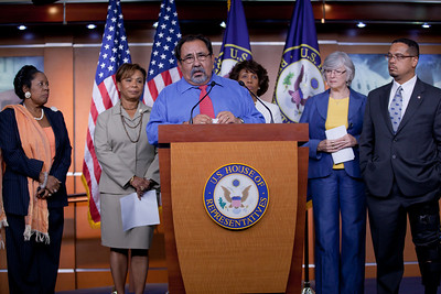 Members of the Congressional Progressive Caucus came out against the debt ceiling deal of President Barack Obama and congressional leadership. Left to right in photo - Sheila Jackson Lee (D-TX), Barbara Lee (D-CA), Raúl M. Grijalva (D-AZ) (at the podium), Maxine Waters (D-CA), Lynn Woolsey (D-CA), Keith Ellison (D-MN). At a press conference on Capitol Hill in Washington DC on August 1, 2011. (Photo by Jeff Malet)