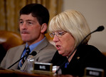 Supercommittee Co-Chair Senator Patty Murray (D-WA) (right) questions witnesses while Co-Chair Rep. Jeb Hensarling (R-TX) (left background) listens. Congress' Joint Select Committee on Defic ...