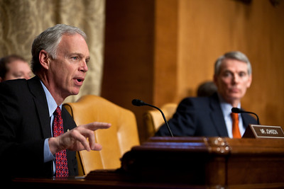 Senator Ron Johnson (R-WI) questions Douglas Elmendorf, the director of the Congressional Budget Office, at his testimony on the budget and economic outlook before the Senate Budget Committee on Thursday January 27, 2011 on Capitol Hill in Washington DC. The CBO estimated that week that the deficit for fiscal year 2011 would grow to $1.5 trillion and in 10 years. In photo Senator Rob Portman (R-OH) sits in background. (Photo by Jeff Malet)