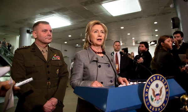 Secretary of State Hillary Rodham Clinton, accompanied by Joint Chiefs Vice Chairman Gen. James Cartwright, speaks to reporters about recent events in Egypt and elsewhere in the Middle East on Capitol Hill in Washington DC on Thursday, February 17, 2011. (Photo by Jeff Malet)