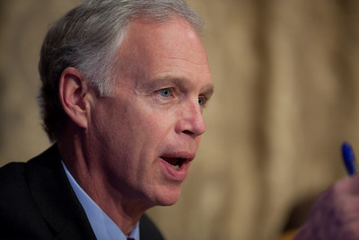 Senator Ron Johnson (R-WI) questions Douglas Elmendorf, the director of the Congressional Budget Office, at his testimony on the budget and economic outlook before the Senate Budget Committee on Thursday January 27, 2011 on Capitol Hill in Washington DC. The CBO estimated that week that the deficit for fiscal year 2011 would grow to $1.5 trillion. (Photo by Jeff Malet)
