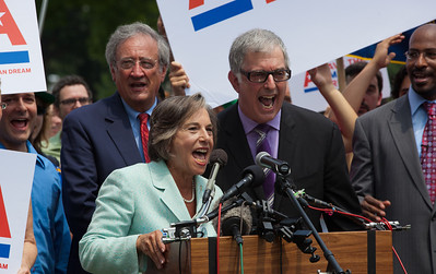 "Representative Jan Schakowsky (D-IL) leads in singing ""This Land is Your Land"" at the close of a rally held outside the Capitol Building in Washington D.C.on Thursday, July 28, 2011. The rally to ""Save the American Dream"" was organized to tell Democrats to stand strong against Republican debt ceiling proposals that cut Social Security, Medicare and Medicaid while keeping keep tax breaks for millionaires, billionaires and oil companies. Participants included major labor unions such as AFSCME, CWA, AFGE, Teamsters, and various progressive groups such as Move-On, American Dream Movement, Jobs with Justice, Gray-Panthers and Code-Pink. (Photo by Jeff Malet)"