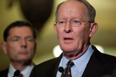 Senator Lamar Alexander speaks with reporters on Capitol Hill in Washington, Tuesday, July 19, 2011, following the weekly Republican policy meeting. Alexander was joined by Senate Minority Leader Mitch McConnell (R-KY) and Senator John Barrasso (R-WY). (Photo by Jeff Malet)