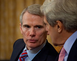 Supercommittee members Senator Rob Portman (R-OH) (left) and Senator John Kerry (D-MA) chat during proceedings. Congress' Joint Select Committee on Deficit Reduction, also known as the Super ...