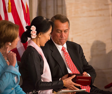 Myanmar democracy leader Aung San Suu Kyi received the Congressional Gold Medal, the highest honor Congress can bestow, at a ceremony Wednesday on September 19, 2012 in the U.S. Capitol Rotunda in Washington D.C. Speaker John Boehner (R-OH) hands the boxed Congressional Gold Medal to Aung San Suu Kyi at the conclusion of the special ceremony. Aung San Suu Kyi was first awarded the Congressional Gold Medal in 2008, while she was under15 years of house arrest in her native country. This day she was there in person to receive the honor. Others attending the ceremony included Secretary of State Hillary Clinton and Former First Lady Laura Bush. (Photo by Jeff Malet)