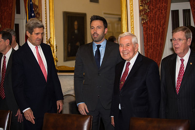 Ben Affleck, in Washington D.C. this week to  raise awareness about violence in the Congo, meets with members of the Senate Foreign Relations Committee on Capitol Hill on Wed., Dec 19, 2012.  Left to right in photo, Senator John Kerry (D-MA), Ben Affleck, Richard Lugar (R-IN) and Johnny Isakson (R-GA). Actor-director Affleck is among the names rumored to replace Kerry on the Democratic ballot for Massachusetts Senator should Kerry become the next U.S. Secretary of State. (Photo by Jeff Malet)