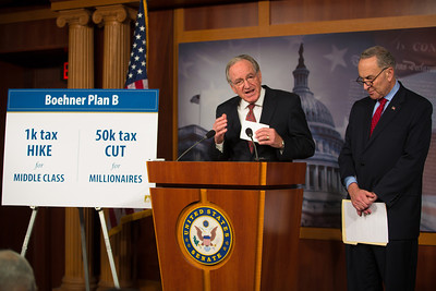Sen. Tom Harkin (D-Iowa), left, and Sen. Charles Schumer (D-NY) hold a news conference at the Capitol in Washington D.C. on Wednesday, Dec. 19, 2012, to respond to Speaker John Boehner's (R-Ohio)  'plan B'  to avoid 'fiscal cliff' impending tax increases and budget cuts at the end of 2012 if Congress cannot reach a new budget agreement. (Photo by Jeff Malet)