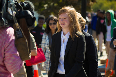 Abigail Fisher walks from the Supreme Court on October 10, 2012 in Washington D.C. The Supreme Court had just heard her challenge to its long-standing ruling that race may be considered as a factor in the admissions process (affirmative action). Justices were debating the case of Fisher v. University of Texas. The outcome could have major implications for higher education. (Photo by Jeff Malet)