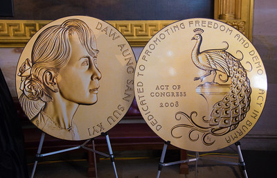 Large scale replicas of the special Congressional Gold medal were on display as Myanmar democracy leader Aung San Suu Kyi received the the highest honor Congress can bestow, at a ceremony Wednesday on September 19, 2012 in the U.S. Capitol Rotunda in Washington D.C. Secretary of State Hillary Clinton and former First Lady Laura Bush joined congressional leaders to pay tribute to  Aung San Suu Kyi who was first awarded the Congressional Gold Medal in 2008, while she was under 15 years of house arrest in her native country. Four years after being awarded the Medal, Aung San Suu Kyi was finally able to accept the honor in person.  (Photo by Jeff Malet)