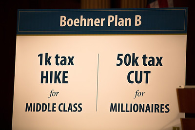 Sen. Charles Schumer (D-NY), and Sen. Tom Harkin (D-Iowa), hold a news conference using this visual display at the Capitol in Washington D.C. on Wednesday, Dec. 19, 2012, to respond to Speaker John Boehner's (R-Ohio)  'plan B'  to avoid 'fiscal cliff' impending tax increases and budget cuts at the end of 2012 if Congress cannot reach a new budget agreement. (Photo by Jeff Malet)