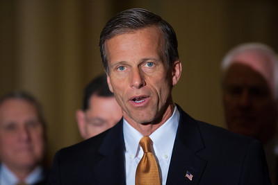 Sen. John Thune (R-SD) joins Senate Minority Leader Mitch McConnell (R-KY) as they talk to reporters following the Republicans' weekly strategy session at the Capitol in Washington D.C. on Tuesday, February 28, 2012. (Photo by Jeff Malet)