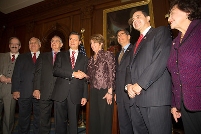 House Democratic Leader Nancy Pelosi (D-CA) and members of the Congressional Hispanic Caucus greet Mexican President-Elect Enrique Pena Nieto (4th from left in photo). Pena Nieto delivered brief remarks in the Rayburn Room at the U.S. Capitol building on November 27, 2012 in Washington, D.C. Pena Nieto's July election victory marked the return to power of the former ruling Institutional Revolutionary Party (PRI) after a 12-year absence. He would also visit the White House and meet with President Barack Obama, just a few days before he takes office on December 1.  (Photo by Jeff Malet)