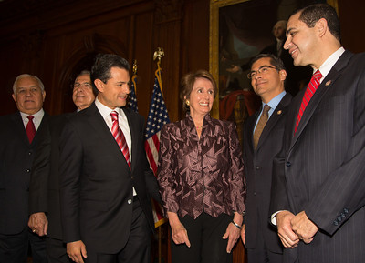 House Democratic Leader Nancy Pelosi (D-CA) and members of the Congressional Hispanic Caucus greet Mexican President-Elect Enrique Pena Nieto (3rd from left in photo). Pena Nieto delivered brief remarks in the Rayburn Room at the U.S. Capitol building on November 27, 2012 in Washington, D.C. Pena Nieto's July election victory marked the return to power of the former ruling Institutional Revolutionary Party (PRI) after a 12-year absence. He would also visit the White House and meet with President Barack Obama, just a few days before he takes office on December 1.  (Photo by Jeff Malet)