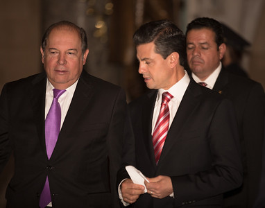 Mexican President-Elect Enrique Pena Nieto (right) chats with David Lopez, his communications director while walking through Statuary Hall in the U.S. Capitol, after delivering brief remarks on November 27, 2012 in Washington, D.C. He appeared earlier with House Democratic Leader Nancy Pelosi (D-CA) and members of the Congressional Hispanic Caucus. Pena Nieto's July election victory marked the return to power of the former ruling Institutional Revolutionary Party (PRI) after a 12-year absence. Pena Nieto would also visit the White House and meet with President Barack Obama, just a few days before taking office on December 1. (Photo by Jeff Malet)
