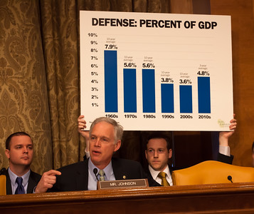 Senator Ron Johnson (R-WI) presents a chart of the cost of defense as a percent of GDP. Leon Panetta, Secretary of Defense; and Army General Martin E. Dempsey, Chairman, Joint Chiefs of Staff testify at a hearing of the Senate Budget Committee on the proposed fiscal 2013 budget request for the Department of Defense on Tuesday, February 28, 2012 on Capitol Hill in Washington D.C. (Photo by Jeff Malet)