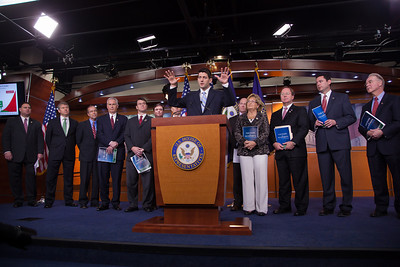 """House Budget Committee Chairman Rep. Paul Ryan (R-WI), center, introduces his budget plan, titled """"The Path to Prosperity""""  during a news conference on Capitol Hill in Washington D.C. on Tuesday, March 20, 2012. (Photo by Jeff Malet)"""