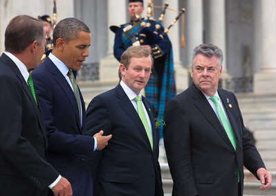 President Barack Obama welcomed Irish Prime Minister Enda Kenny to Washington as part of an extended St. Patrick's Day celebration. In photo from left, House Speaker John Boehner (R-OH), President Barack Obama, Irish Prime Minister Edna Kenny, and Rep. Peter King (R-NY), walk down the steps of the Capitol in Washington on Tuesday, March 20, 2012, following a luncheon inside the Capitol. The leaders all wore green ties and were serenaded by the United States Air Force Reserve Pipe Band. (Photo by Jeff Malet)